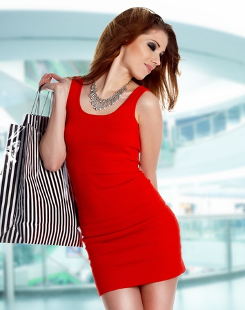 lovely woman with shopping bags over white  Stock Photo - 13321607
