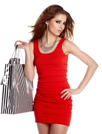 closeup on bags: Beautiful, young, woman with colorful shopping bags in her hand  Stock Photo