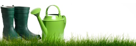 Extra large horizontal strip of grass and garden tools on white background   photo