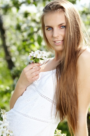 The image of a beautiful girl was blossoming apple orchard  Stock Photo - 13476516