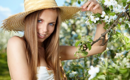 portrait of young lovely woman in spring flowers  photo