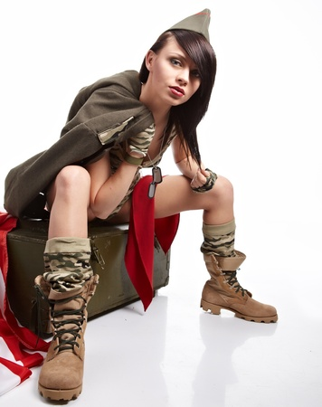 camouflage woman: Beautiful girl in military clothes  studio shot