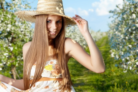 portrait of young lovely woman in spring flowers over amazing garden Stock Photo - 13539840