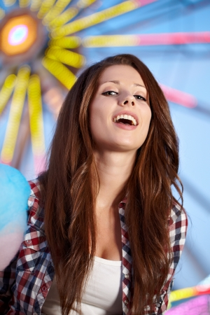 amusement: Smiling woman in amusement park. Focus on face.