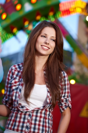 Smiling woman in amusement park. Focus on face. Stock Photo - 13713375