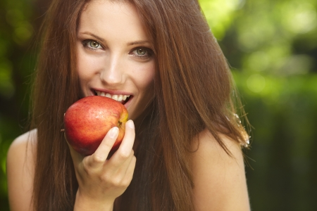 eva: Woman with apple in garden Stock Photo