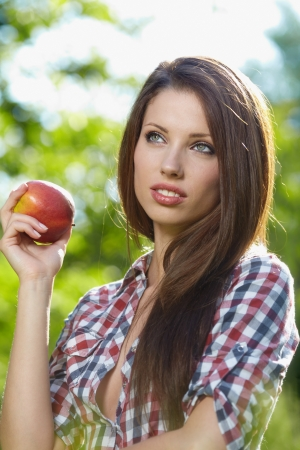 garden of eden: Beautiful woman  in the garden with apples Stock Photo