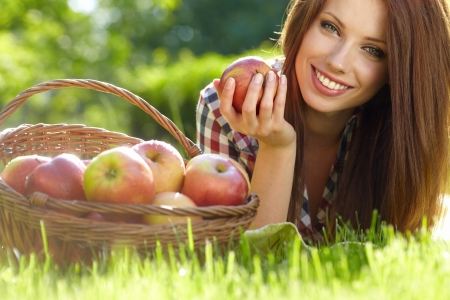 Beautifuwoman  in the garden with apples photo