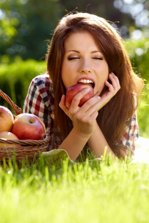 Beautifuwoman  in the garden with apples Stock Photo - 13756874