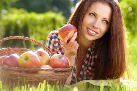 Beautifuwoman  in the garden with apples Stock Photo - 13756886