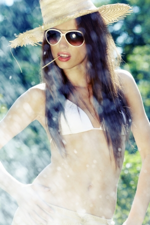 Summer woman in swimsuit and hat Stock Photo - 13772510