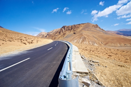 yellowish mountain road view in tibet of China  photo