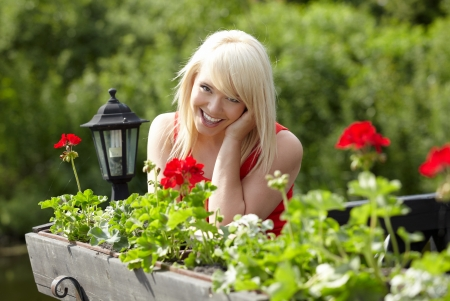 Beautiful  sexy young blonde woman in balcony  photo