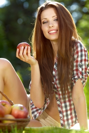 Beautiful  woman in the garden with apples Stock Photo - 13901705