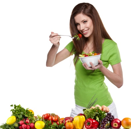 Woman with salad isolated on white Stock Photo - 13901696
