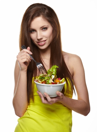 woman on scale: Woman with salad isolated on white