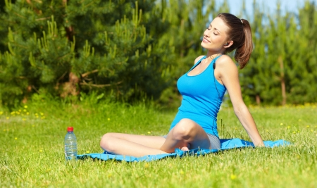 Beautiful happy smiling sport fitness model outside on summer spring day