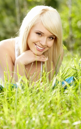 girl on green field  photo