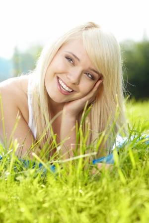 girl on green field  photo