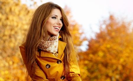 autumn hair: Beautiful elegant woman standing in a park in autumn