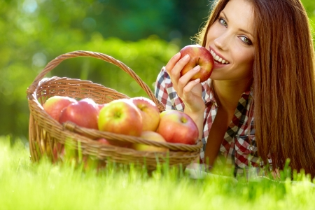 Beautiful woman in the garden with apples Stock Photo - 13940881