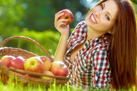 Beautiful woman in the garden with apples Stock Photo - 13940909