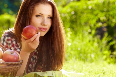 Beautiful woman in the garden with apples Stock Photo - 13940868