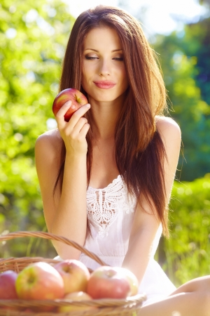 Beautiful woman in the garden with apples Stock Photo - 13940802