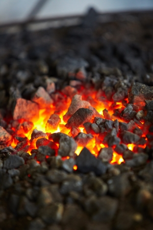 molted: Old-fashioned blacksmith furnace with burning coals