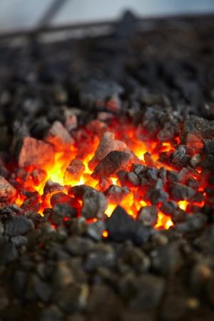 coals: Old-fashioned blacksmith furnace with burning coals