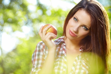 Beautiful woman in the garden with apples Stock Photo - 14207825