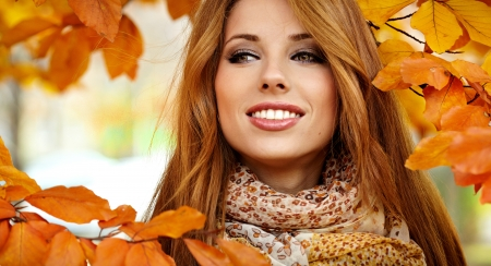 autumn hair: Beautiful elegant woman standing in a park in autumn