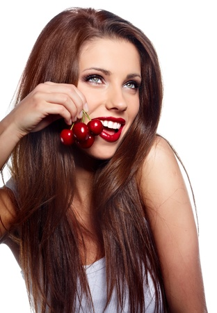 wet lips: Happy health woman with cherry isolated on white background  Stock Photo