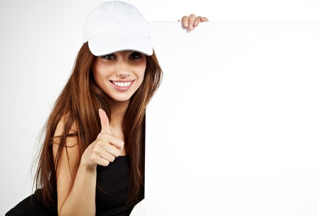 beautiful smiling girl holding a blank billboard   photo