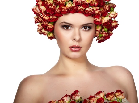 Portrait of young beautiful woman with rose in hair, on white background  photo