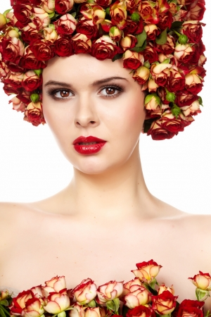 Portrait of young beautiful woman with roses in hair, on white background  photo