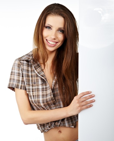 Happy smiling beautiful young  woman showing blank signboard, isolated over white background  photo