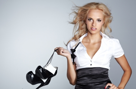 shoe model: Beautiful woman after party holding shoes . Girl and shoes Stock Photo