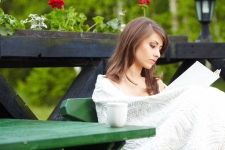 Young  woman with cup outdoors  photo