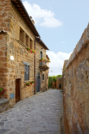 Narrow Alley With Old Buildings In Italian City  photo