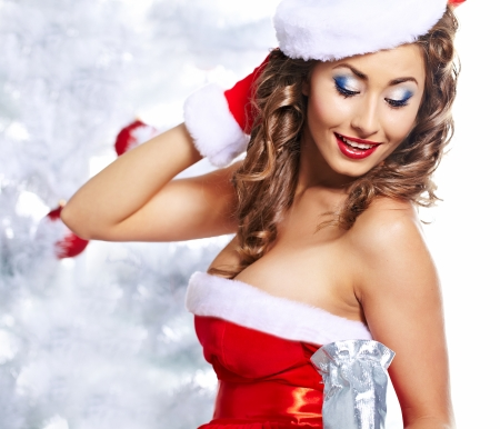 sexy santa girl: winter girl with christmas gift  Stock Photo
