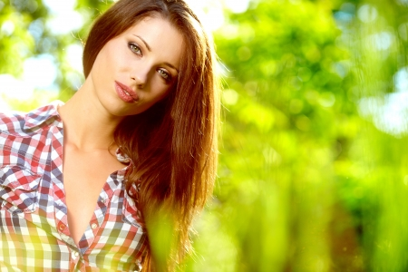 Portrait of a beautiful woman in the garden  photo