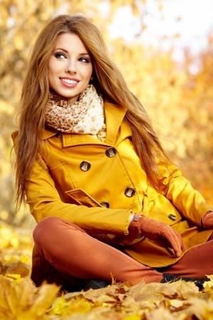 pretty lady: young brunette woman portrait in autumn color  Stock Photo