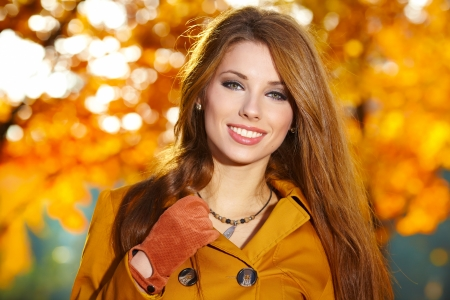 young brunette woman portrait in autumn color  photo