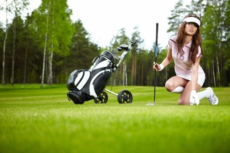 Woman and golf  photo