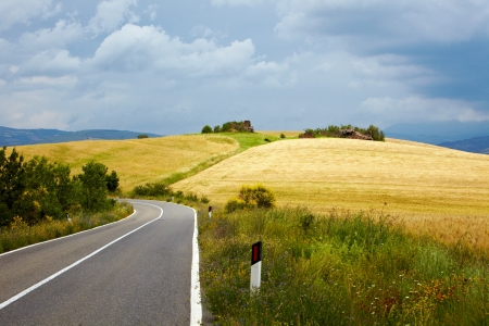 Typical landscape in Val dOrcia ( Tuscany, Italy) at summer. Road . photo