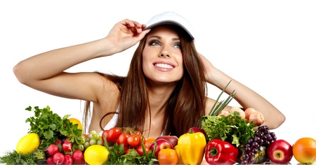 Young smiling woman with variety of fresh vegetables and fruits isolated on white  photo