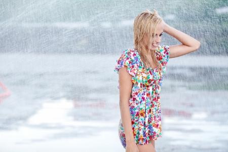 splutter: portrait of young beautiful woman in rain