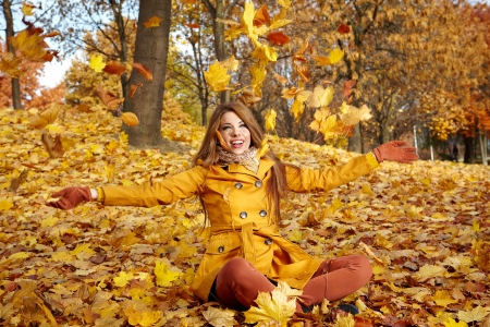 street fashion: young brunette woman portrait in autumn color  Stock Photo