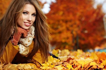 young woman portrait  in autumn park